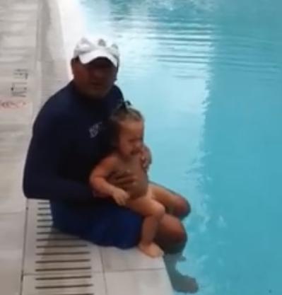 kid thrown in pool