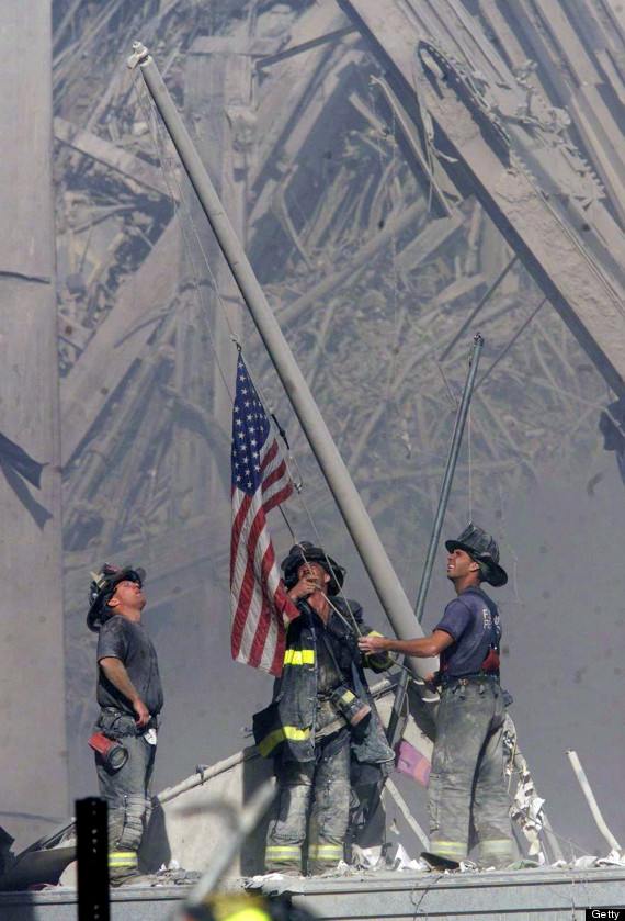 Firefighters Raise A U.S. Flag At The Site Of The World Trade Center